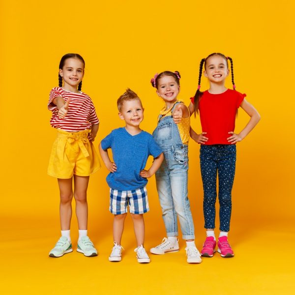 Group,Of,Cheerful,Happy,Children,On,A,Colored,Yellow,Background