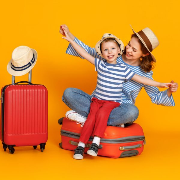 Happy,Journey!,Family,Of,Travelers,Mother,And,Child,With,Suitcases